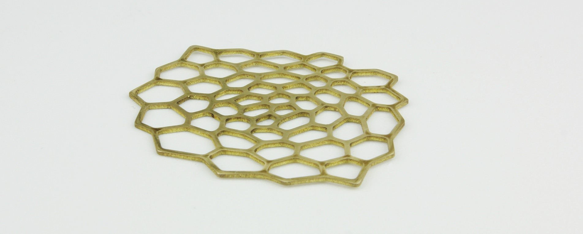 Laser cutting of jewelry decorations of brass material 1 mm thick