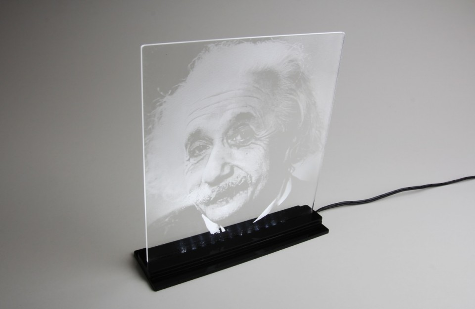 Laser rastering of an image on to an acrylic plate illuminated with LED lighting