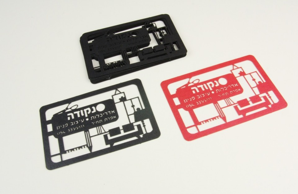 Laser cutting of designed business cards (design: dot - architecture and interior design)