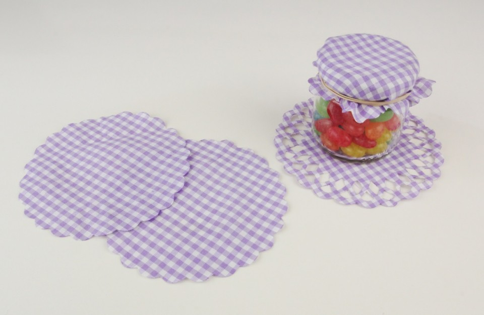 Laser cutting of fabric use as a decorative cover for jars