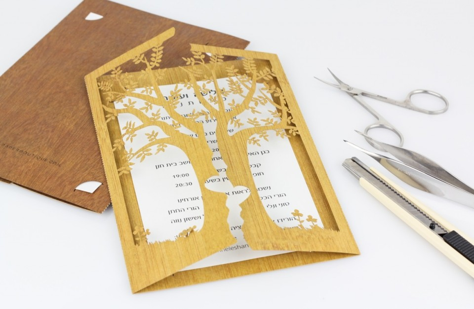 Designed invitation cut with a laser made of wood like paper