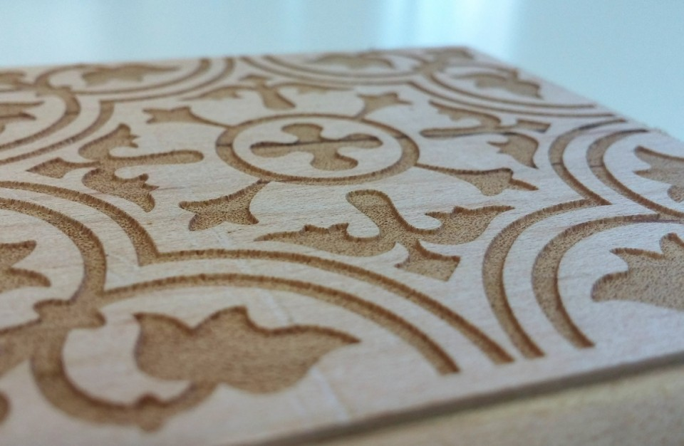 A floral design laser engraved on a maple tree for decorative use