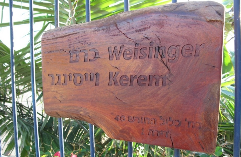 Laser Engraving on anoutdoor wood sign at the entrance to the house