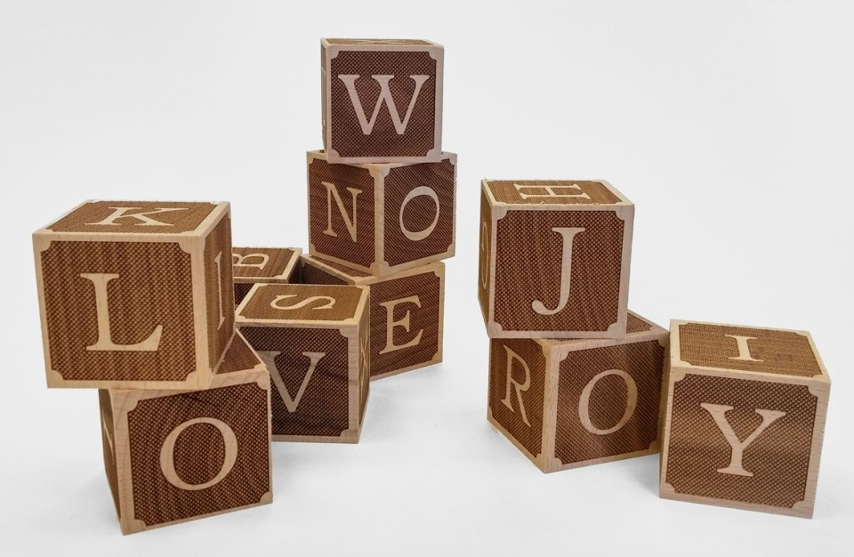 Wooden playing cubes - letters engraving with laser technology