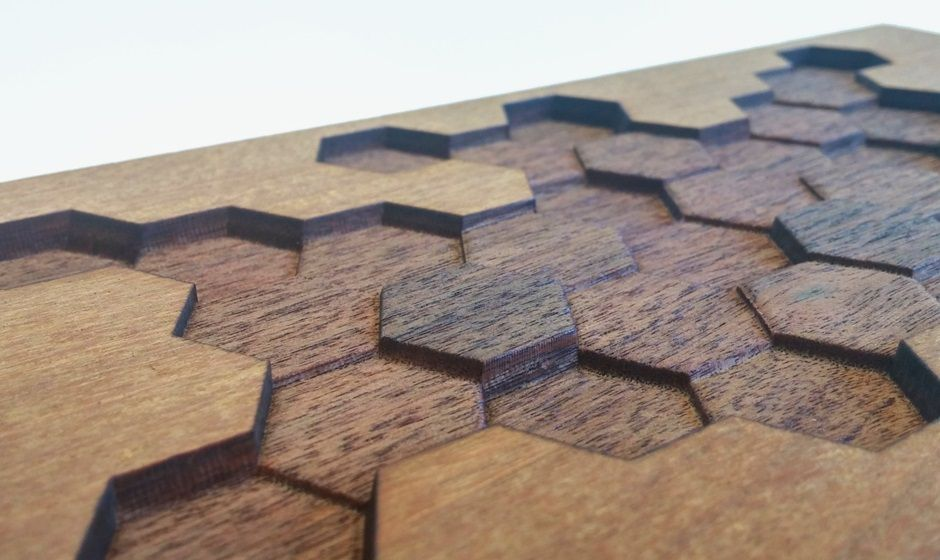 Wood paneling with laser engraving in variable depths